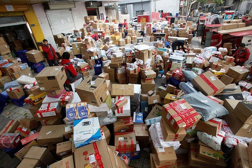 Staff sorting boxes and parcels at a JD.com logistics station in China last year. Major e-commerce companies in China are looking to bulk up their logistics businesses to support their global expansion ambitions and boost revenues by offering service