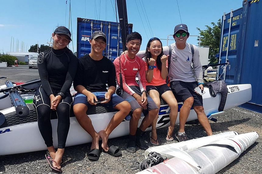From left: Youth sailors Sophia Rose Meyers, Chia Teck Pin, Raynn Kwok, Vicke Young and coach Terence Koh are delighted after Sophia and Teck Pin ended qualifying as the top non-Australian pair.