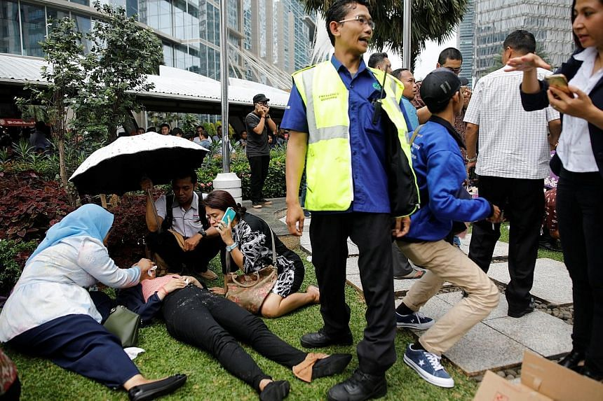 People searching for those trapped beneath debris after the walkway collapse in Jakarta yesterday. The incident took place a day after the second anniversary of the Jan 14, 2016, suicide attack in Jakarta, feeding into initial fears that it was a ter