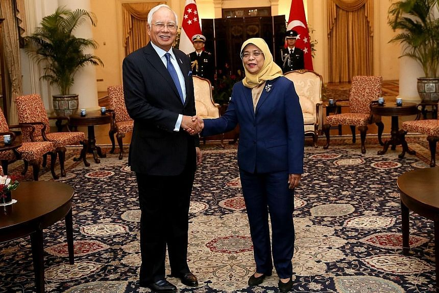Malaysian Prime Minister Najib Razak calling on President Halimah Yacob at the Istana yesterday for the first time since she took office.