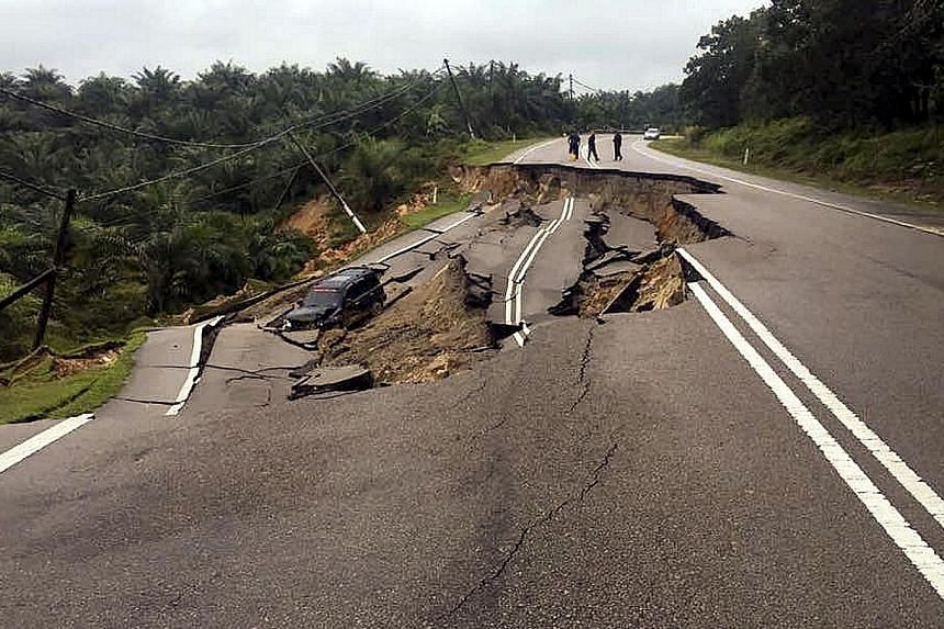 The main road linking Johor Baru and Kuantan was closed to all vehicles after a landslide yesterday. Three people, including a 60-year-old, travelling on the road escaped death when their car skidded and fell into a ravine near the landslide.