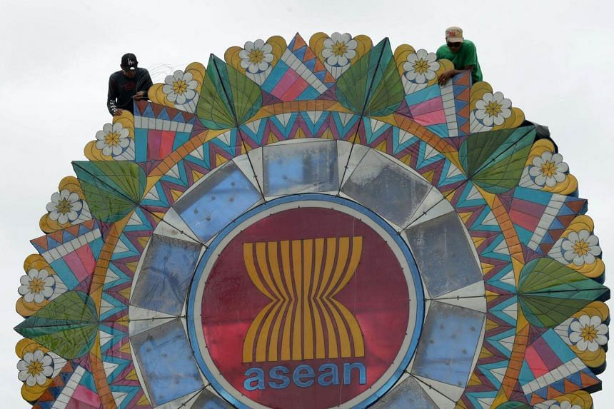 A giant lantern decorated with the logo of Asean displayed at the entrance to the venue of the Asean Regional Forum meeting in Manila on Aug 3, 2017.
