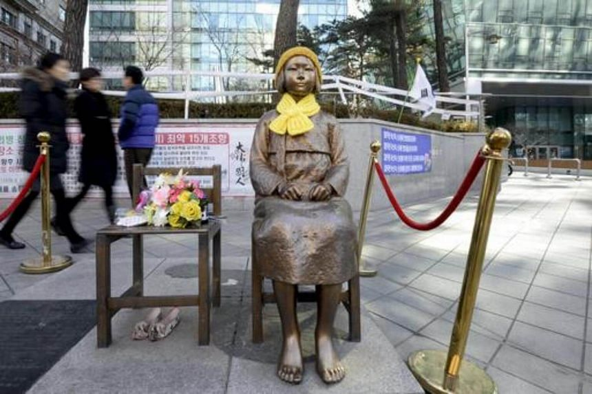 A statue of a girl that represents the sexual victims by the Japanese military is seen in front of Japanese embassy in Seoul, on Dec 28, 2015.