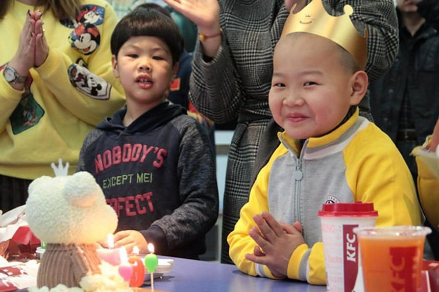 Xiaochangjiang (right) spends his first celebrated birthday at a welfare house in Qingdao, Shandong province, on Jan 14, 2018.