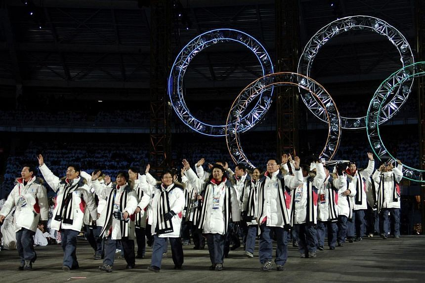 North and South Korean athletes marching together during the opening ceremony of the 2006 Winter Olympics in Turin.