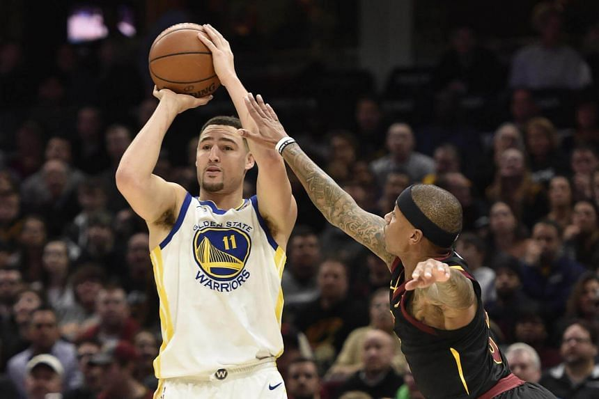 Golden State Warriors guard Klay Thompson shoots a three-point basket during the game's first quarter, on Jan 16, 2017.
