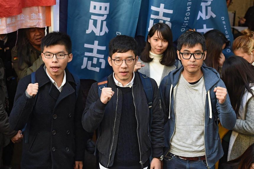 Bailed Hong Kong democracy activists (from left) Joshua Wong, Nathan Law and Alex Chow face the media outside the Court of Final Appeal before their first appeal hearing against jail sentences in Hong Kong, on Jan 16, 2018.