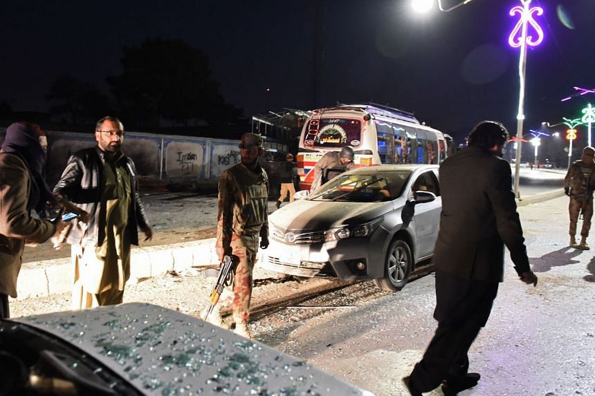 Pakistani security officials gathering at the site of a suicide bomb attack in Quetta on Jan 9, 2018.