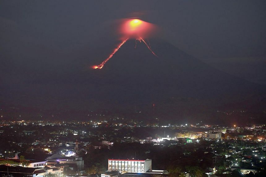 Lava erupts from Mayon volcano, in Legazpi, in the Philippines' Albay province, on Jan 15, 2018.