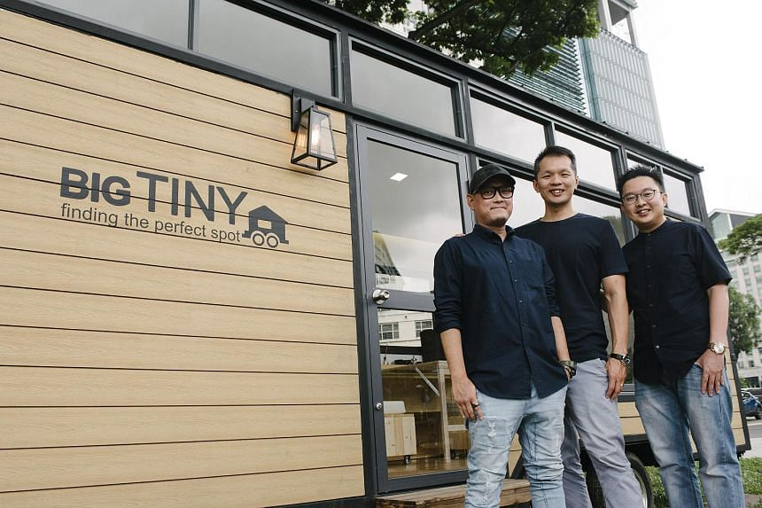 (From left) Big Tiny co-founders Jeff Yeo, Dave Ng and Adrian Chia, together with their Big Tiny prototype house.