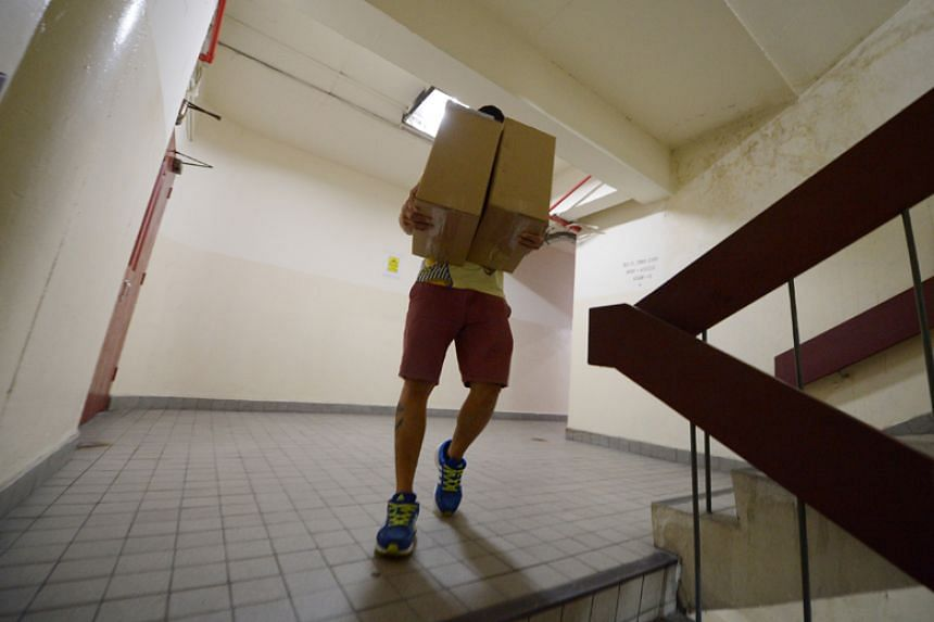 A man uses the stairs at Golden Mile Tower on Jan 16.