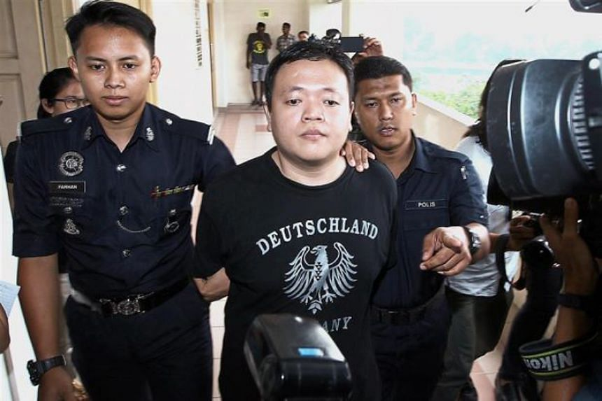 According to a letter from Malaysia's national police chief, Lam Chang Nam (centre), who was charged with extorting money from Pastor Raymond Koh's son, was instead charged on Jan 15 for kidnapping or abduction.