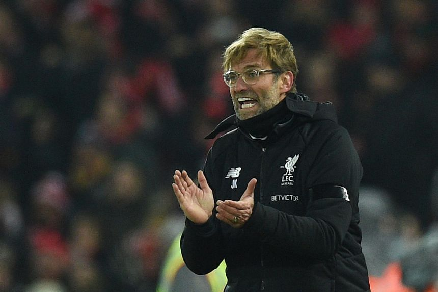 Liverpool's German manager Jurgen Klopp applauds on the touchline during the English Premier League football match between Liverpool and Manchester City on Jan 14, 2018.