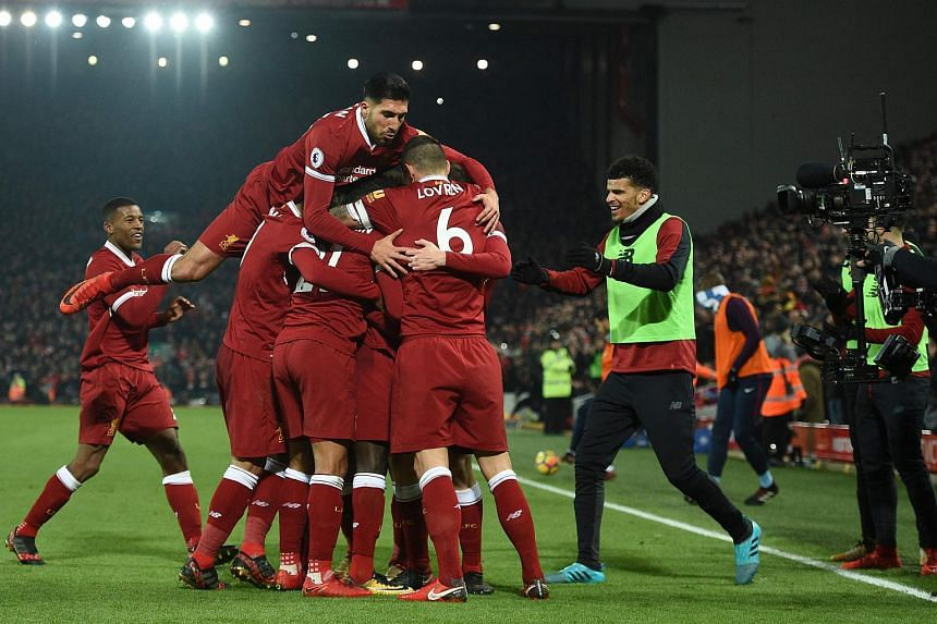 German midfielder Emre Can jumps into the celebration for the third Liverpool goal scored by Sadio Mane during the English Premier League football match between Liverpool and Manchester City.