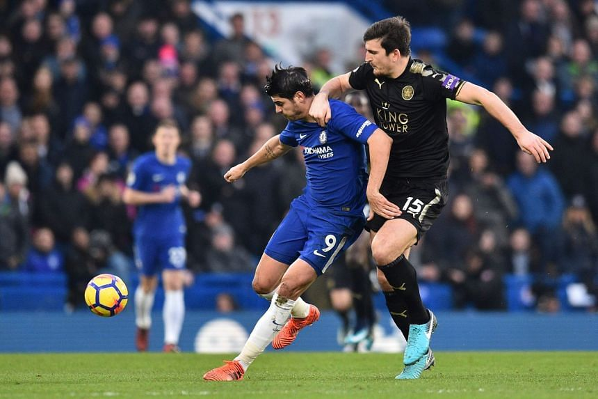 Leicester City's Harry Maguire (right) challenges Chelsea striker Alvaro Morata during the English Premier League football match between Chelsea and Leicester City at Stamford Bridge.