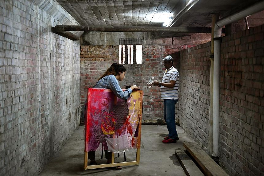 Ms Pooja Kanade, 24, setting up her work titled A Place Of Worship Is Not A Lonely Place with the help of her father, Mr Pramod Kanade, 55.