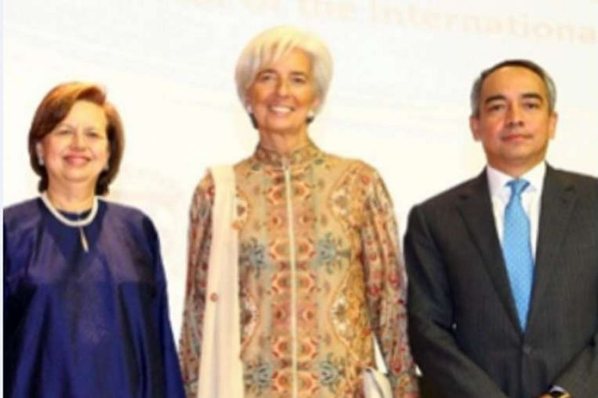 "A photo showing Datuk Seri Nazir Razak with central bank governor Zeti Akhtar Aziz and International Monetary Fund managing director Christine Lagarde. He defended Tan Sri Zeti by posting this picture with the caption: ""My moment with 2 icons of glob"