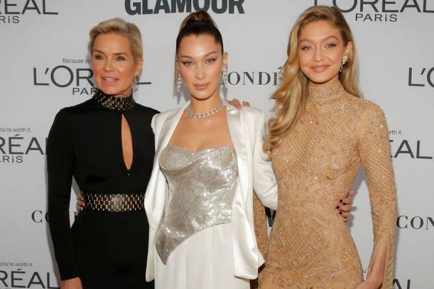 Yolanda Hadid (left) oversees the modelling careers of daughters Bella (centre) and Gigi.