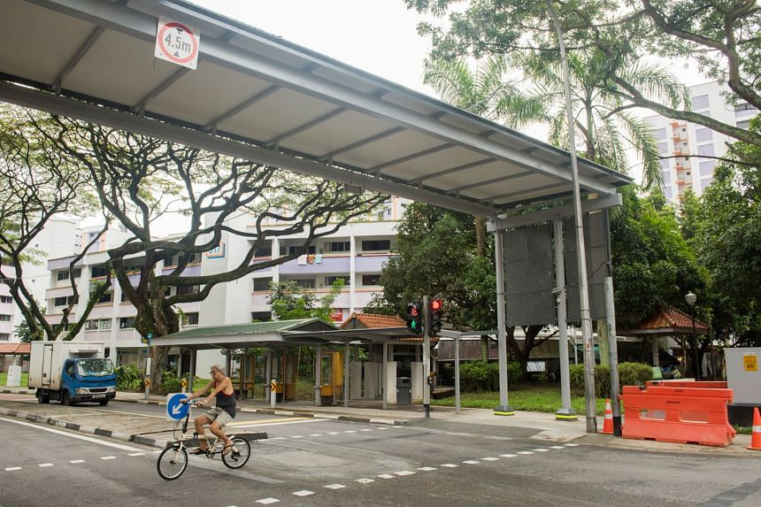 The pedestrian crossing and the shelter not in alignment (left) and the crossing now shifted under the shelter (right), at the entrance of Rulang Primary School in Jurong West Street 52. The photo showing the misalignment had gone viral on Facebook l