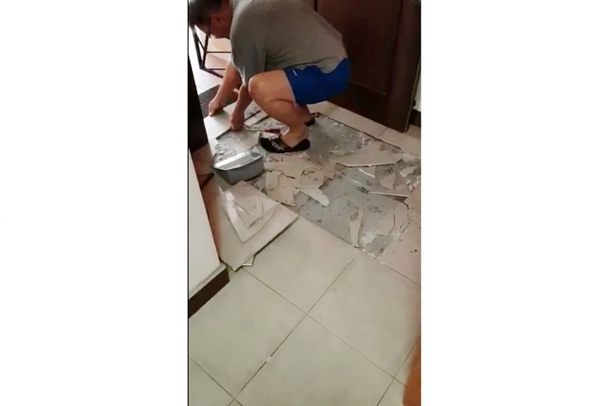 Bukit Panjang resident Rachel Chong posted a video on Facebook of tiles that had popped out and fallen from her kitchen wall (left), while the living room floor tiles in Mr Johnson Ng's Sengkang flat popped up yesterday morning. In the past two years