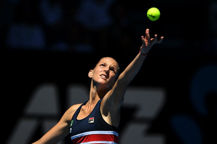 Karolina Pliskova of the Czech Republic serves against Veronica Cepede Royg of Paraguay during round one on day two of the Australian Open in Melbourne on Jan 16.