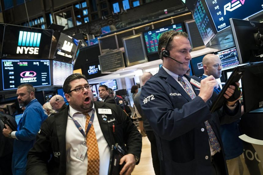 Traders and financial professionals on the floor of the New York Stock Exchange on Jan 12, 2018.