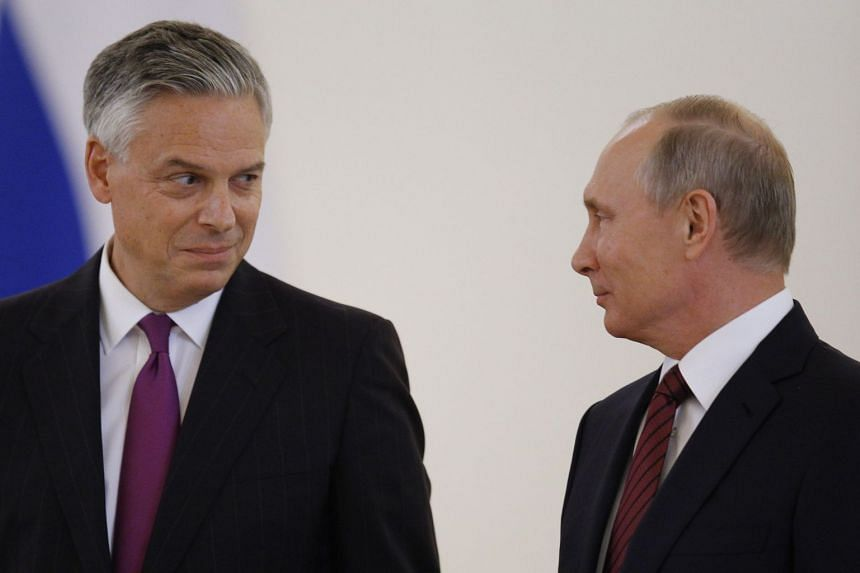 US Ambassador to Russia Jon Huntsman and Russian President Vladimir Putin at the Kremlin in Moscow on Oct 3, 2017.