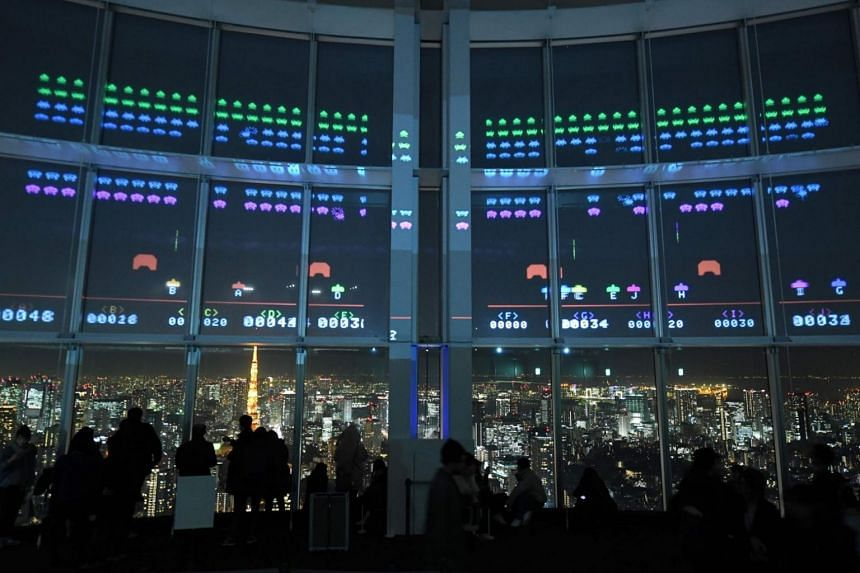 The Space Invaders GigaMax video game being displayed on the windows of the Roppongi Hills observatory in Tokyo on Jan 15, 2018.
