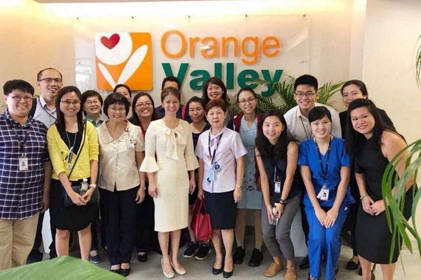 Orange Valley Nursing Home hosting partners from Tan Tock Seng Hospital and the Regional Health System Planning Office at the brand new Balestier Care Centre.
