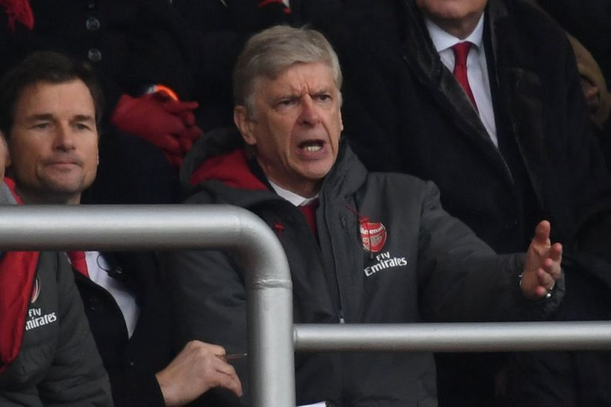 Wenger reacts in the stands as Arsenal play Bournemouth on Jan 14, 2018.