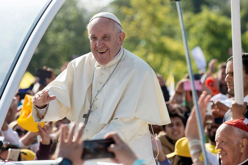 Pope Francis waves to people as he arrives at O'Higgins park to lead a mass, in Santiago, Chile.