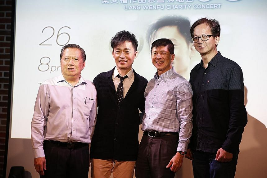 Singer-songwriter Liang Wern Fook (second from left) with (from left) Public Free Clinic Society president Seow Ser Fatt, HCA Hospice Care president Tan Poh Kiang and Ocean Butterflies Music managing director Colin Goh at a press conference yesterday