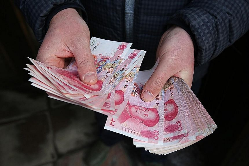 """The yuan has gained increasing global clout in recent years and, in 2016, joined the US dollar, pound, yen and euro in the IMF's elite """"special drawing rights"""" reserve currency basket."""