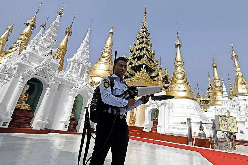 A security officer at the Shwedagon Pagoda in Yangon, Myanmar, carrying an anti-drone gun during the visit of Laotian Prime Minister Thongloun Sisoulith and his wife yesterday. Mr Thongloun and his delegation were on a two-day visit to Myanmar, the L