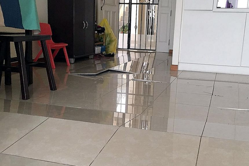 Residents in a Woodlands estate have shared photos of popped tiles in their flats in a WhatsApp chat group. Mr Lewis Sua, who lives at Block 688C, Woodlands Drive 75, said there were at least 14 flats affected in his block alone, and 38 if he include