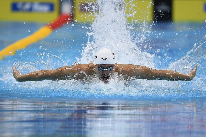 Joseph Schooling during the 100m butterfly heats at July's World Aquatics Championships. His 100m gold at the Rio Olympics established the fly as the stroke of choice for local swimmers.