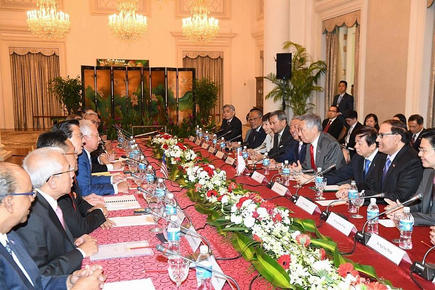 Prime Minister Lee Hsien Loong, along with other Singapore leaders, meeting his Malaysian counterpart Najib Razak and other Malaysian leaders during the retreat yesterday.