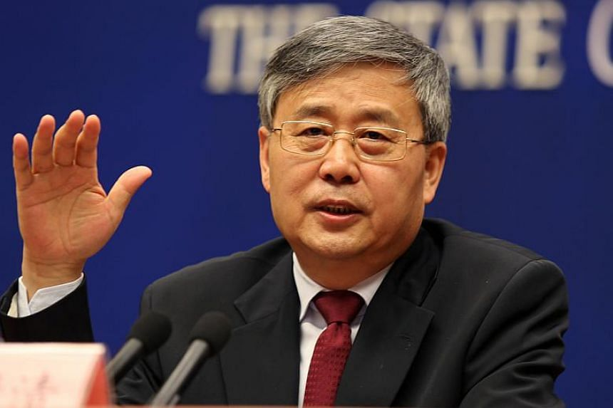 Chairman of the China Banking Regulatory Commission Guo Shuqing at a news conference in Beijing on Mar 2, 2017.