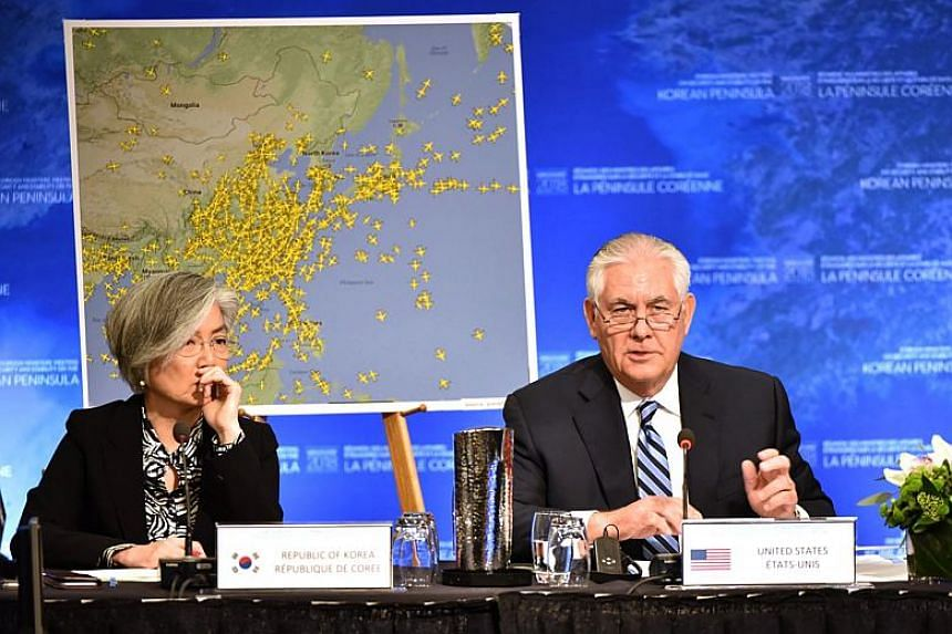 US Secretary of State Rex Tillerson gives his opening remarks as South Korean Foreign Minister Kang Kyung Wha listens at the Vancouver Foreign Ministers Meeting on Security and Stability on the Korean Peninsula, in Vancouver, Canada on Jan 16, 2018.
