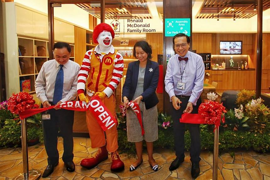 (From left) Chief executive of IMH Chua Hong Choon, president of RMHC Singapore Pamela Tor Das, and chairman of the medical board of IMH Daniel Fung, with the Ronald McDonald mascot at the opening of the new Ronald McDonald Family Room at IMH.