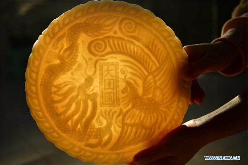 The handmade ciba, or glutinous rice cake, is usually decorated with patterns.
