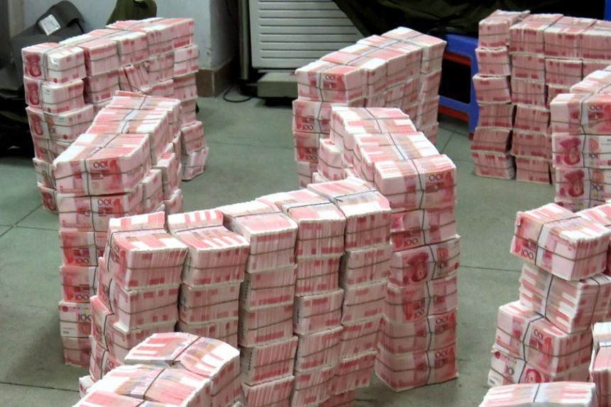 Police in China arrested 14 people and seized counterfeit bank notes with a total face value of more than 214 million yuan.