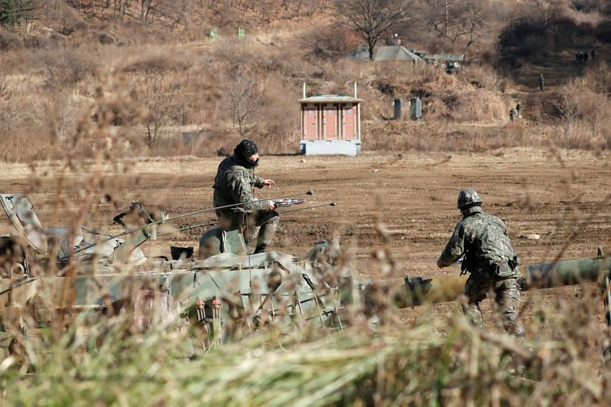 South Korea soldiers taking a break on their self-propelled artillery vehicle during a military exercise on Nov 29, 2017. Seoul raised the salaries of its rank-and-file conscripted soldiers on Jan 17, 2018.