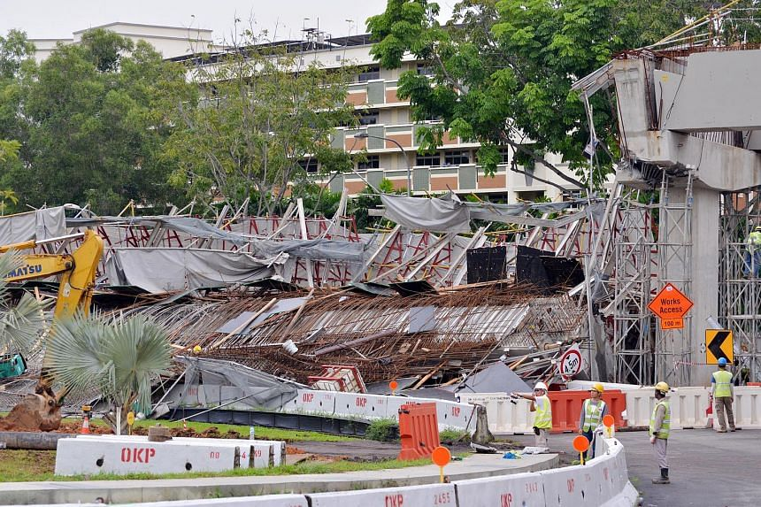 Workers looking at the damaged viaduct after it collapsed, on July 14, 2017.