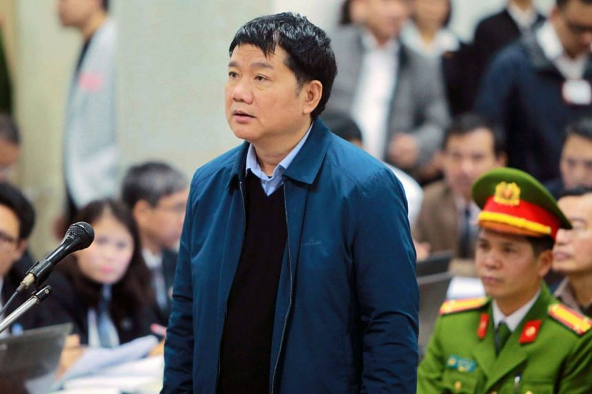 Former PetroVietnam chairman Dinh La Thang standing trial in court in Hanoi on Jan 8.