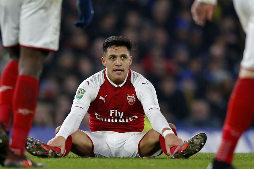 Chile international Sanchez (above) had been strongly linked with a move to either Manchester United or Manchester City.