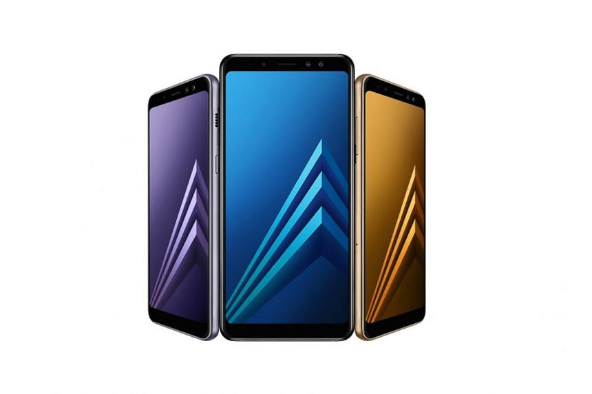 The Galaxy A8 (2018) and A8+ (2018) sport dual front cameras, a near-bezel-less screen and run on Android 7.1.1 Nougat. PHOTO: SAMSUNG