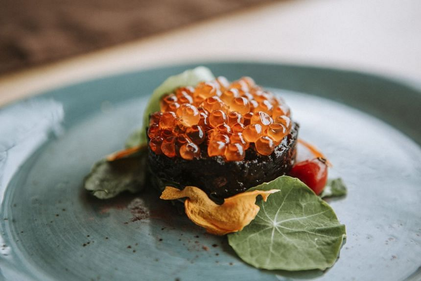 Seal tartare with salmon roe at Ku-kum Kitchen in Toronto, Canada.