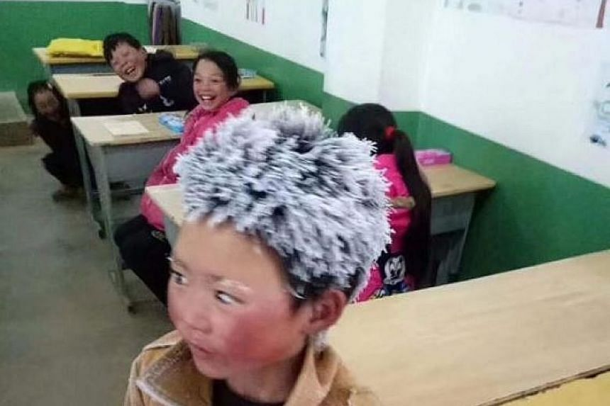 Photos of Wang Fuman in class, shared by his principal, showed the icicles that had formed on his hair and eyebrows during his 4.5km walk in freezing temperatures to go to school.