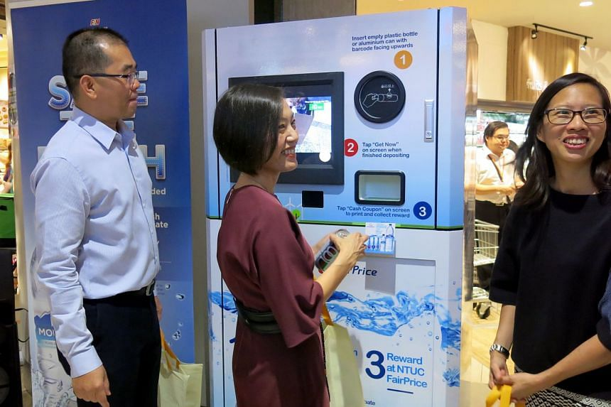(From left) FairPrice deputy chief executive and head of products Tng Ah Yiam, F&N Foods general manager Jennifer See and Frasers Centrepoint general manager of retail properties Stephanie Ho with a reverse vending machine, which identifies, sorts an